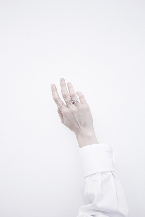 An arm in white shirt against a pure white background