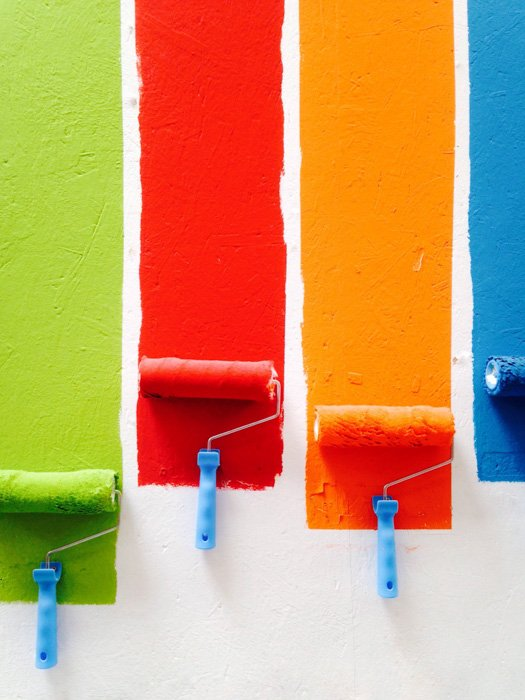 Paint rollers with colorful paint