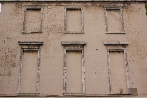 A building showing bricked up windows - Reasons Your Photos Suck