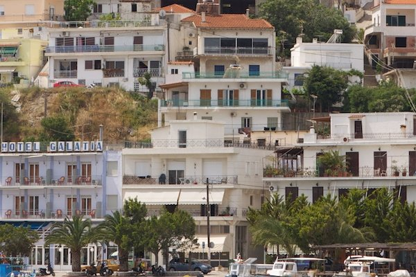 Photo of a sea coastline with houses and hotels on different levels