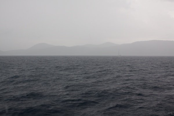 Sea and mountains in the horizon covered in mist
