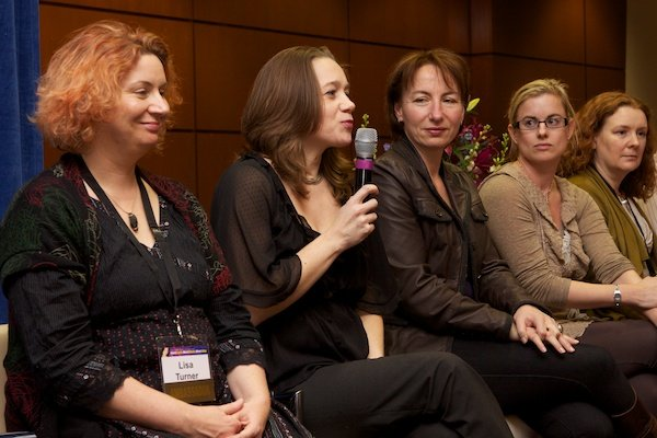 A line of women surround the speaker - Corporate Event Photography