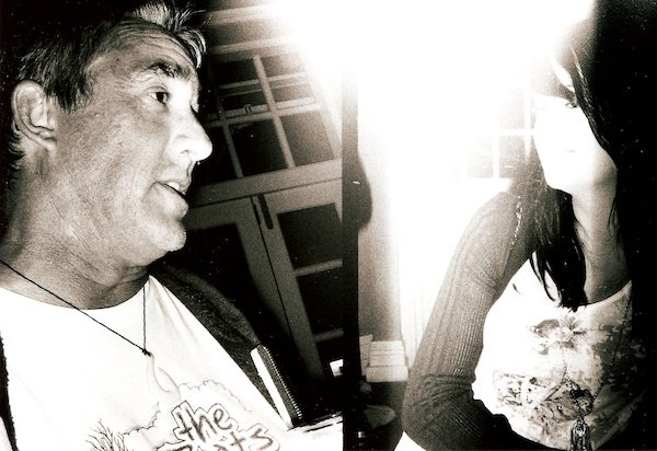 Black and white overexposed photo of a man and a woman taken on film