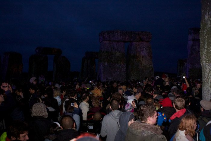 A large crowd at an outdoor event at night - flash photography tips