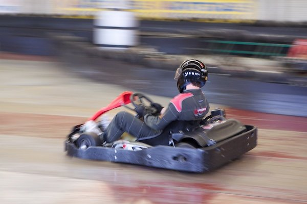 Photo of a person driving a kart