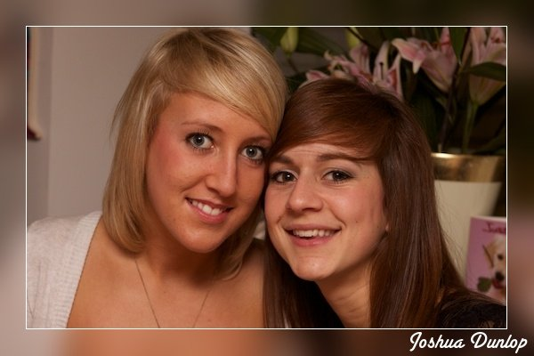 An image of two girls with a border and watermark - Photography Clichés