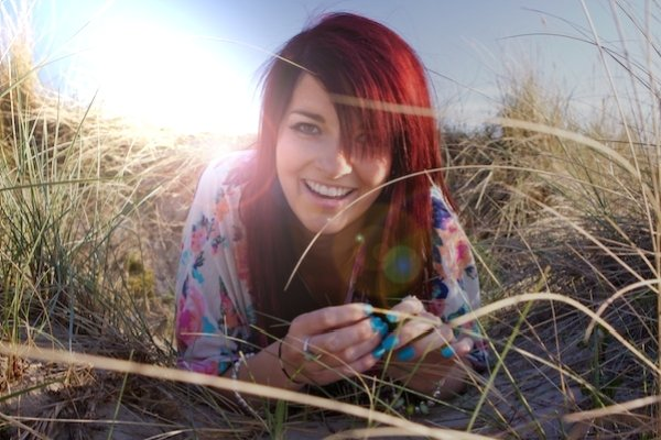 An image of a girl with fake lens flare - Photography Clichés