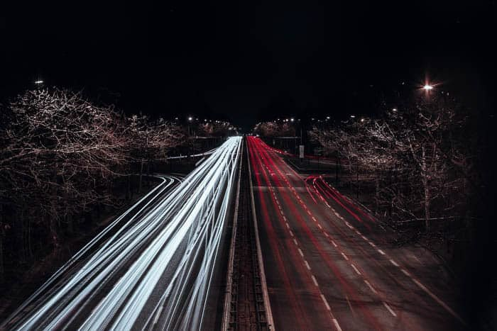 Streaming red and white light trails on a highway shot at f/5.6 for 235 seconds at ISO 100