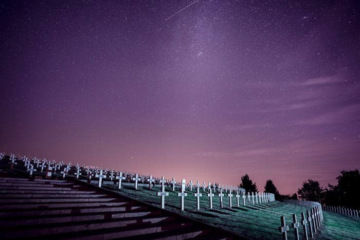 A night photo of a cemetery under a starry sky