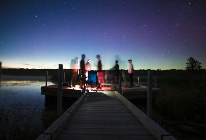 photo of a group of people on a pier with slow sync flash