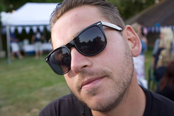 Portrait of a young sunglasses, demonstrating soft background technique in photography