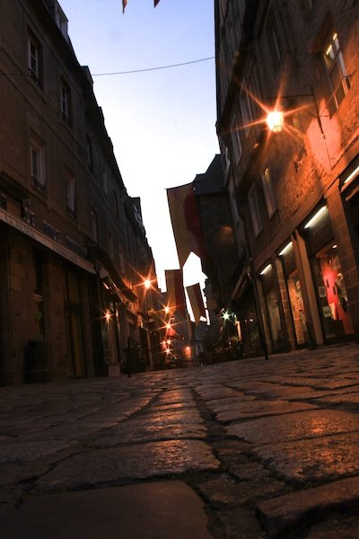 Low angle shot of a city street in low light, with a diagram showing the use of triangles in photography composition