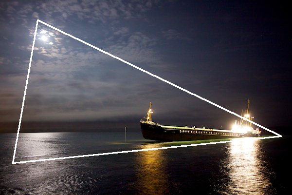 A shot at sea by night, with a diagram showing the use of triangles in photography composition