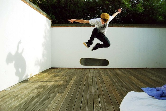 A photo of a skateboarder in mid air demonstrating stability and balance photography