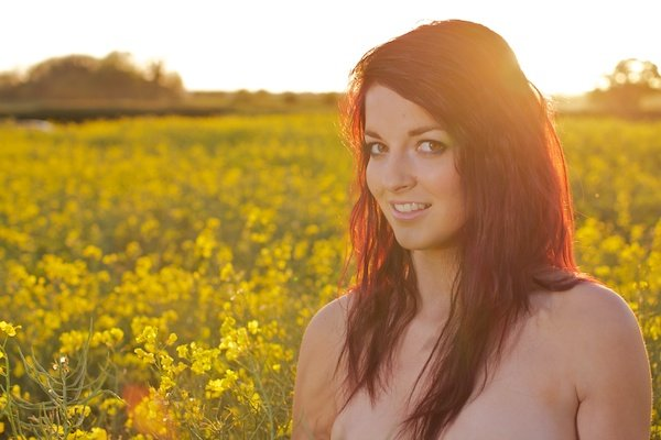Photo of a young woman in the field of yellow flowers demonstrating editing with highlights