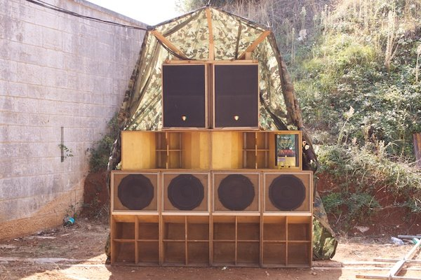 An artistic setup of speakers and cupboards in an outdoor location