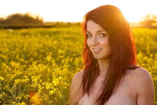Edited photo of a young woman in the field of yellow flowers