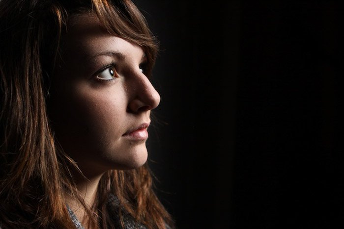 Atmospheric low key portrait of a female model
