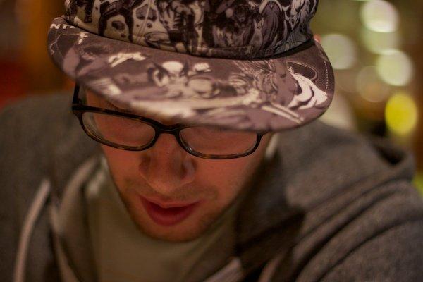 man wearing glasses and baseball cap