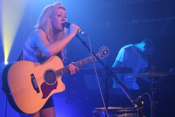 Blond female singer with a guitar