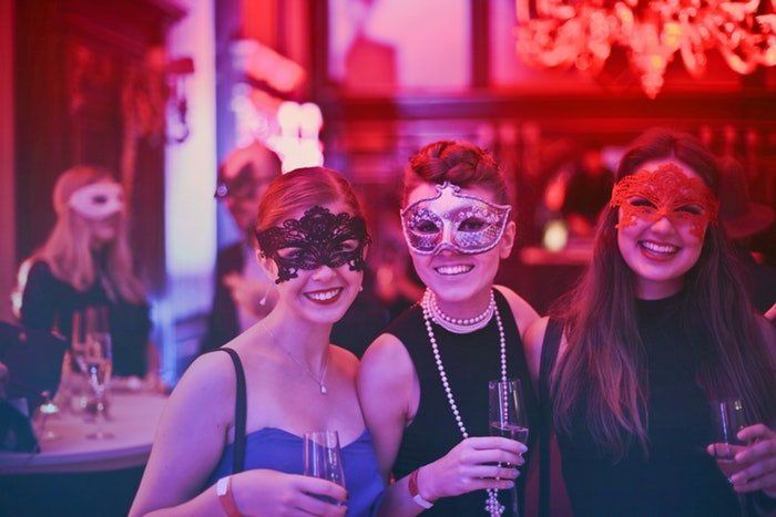 women wearing masks at a party