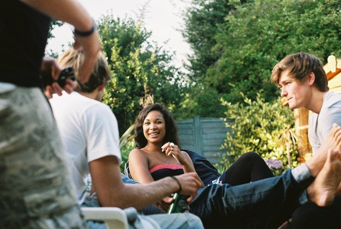 Casual portrait of friends chatting outdoors