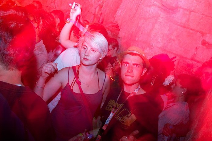 Atmospheric pink toned portrait of people in a nightclub