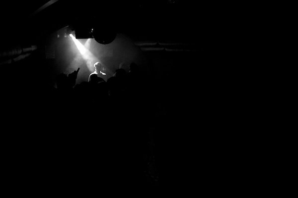 dramatic lighting on a performer in a crowd