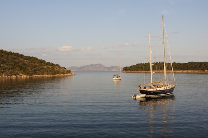 Photo of the sea with a couple of yachts