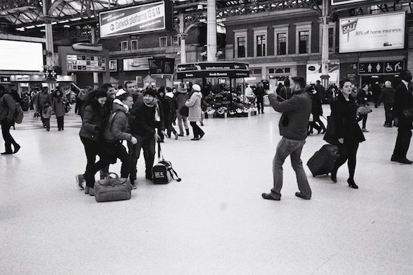 An image of people in Victoria Train station - black and white street photography