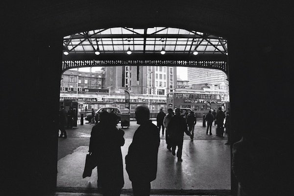 Using a door frame as a natural frame - black and white street photography