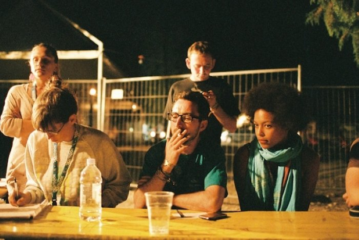 group of friends talking around a table outdoors