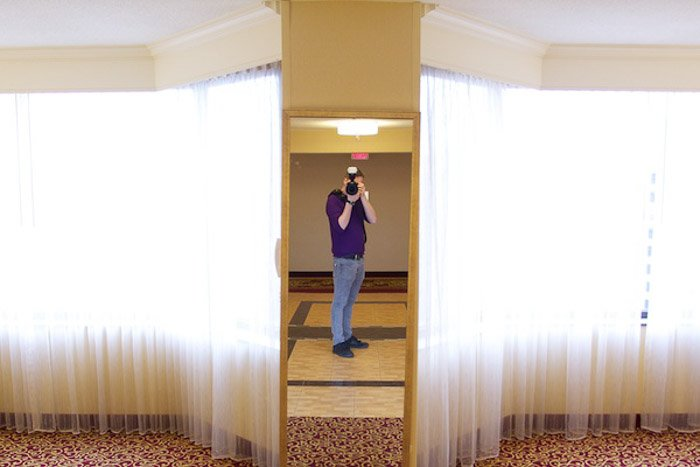 A portrait of the photography shooting a self portarit in the mirroe - photography exposure tips