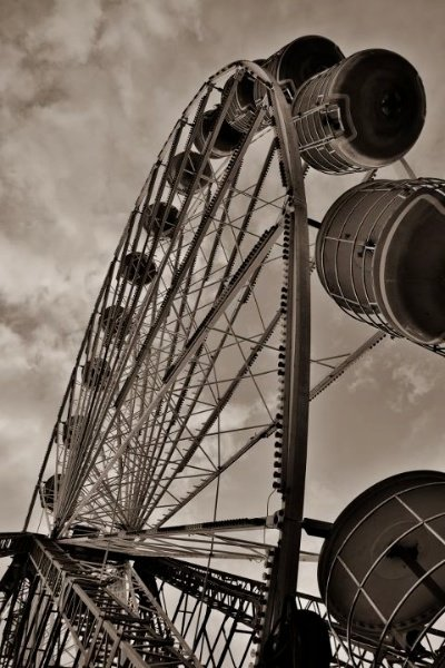 A sepia image of a Ferris wheel. Low Angle – 30 Day Photography Challenge Tips