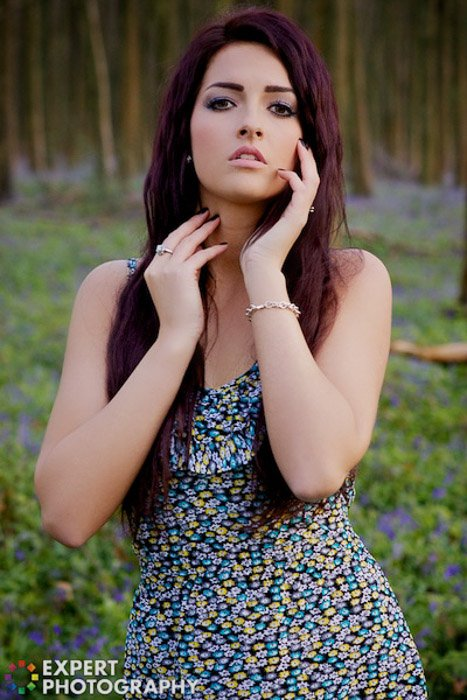 A portrait of a female model posing outdoors