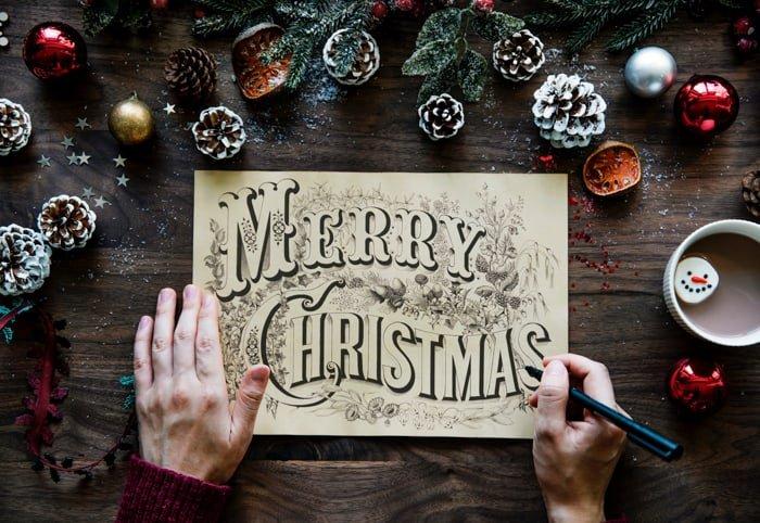A Christmas photography tutorials shot of making a card