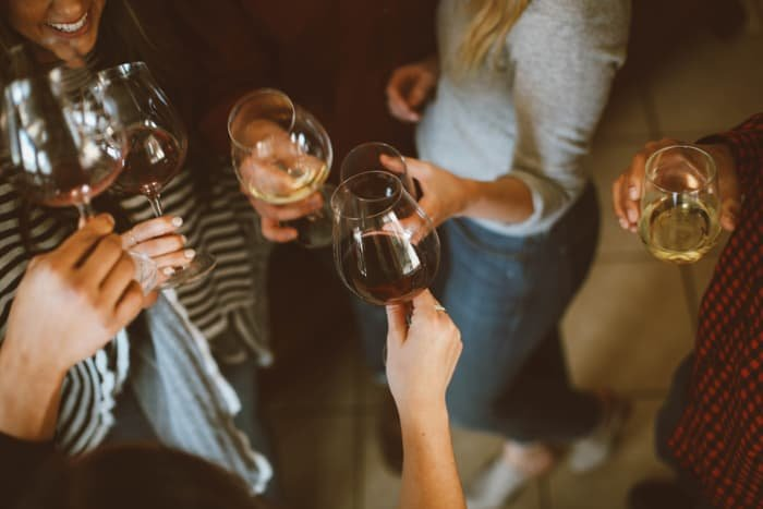Friends drinking wine at a party - christmas photography tutorials