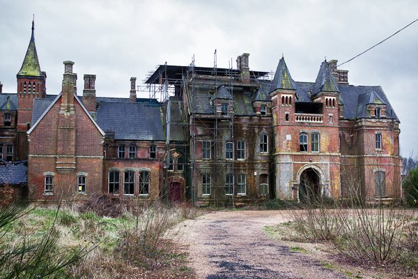 Old red brick building of an old boarding school from the outside
