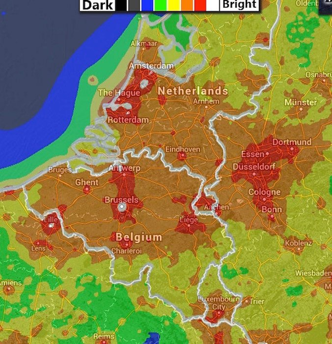 A light-pollution map for Belgium: brighter areas are in red while the darker ones are in black