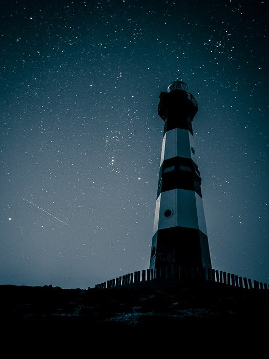 The lighthouse in Bresken (the Netherland) against the winter sky.