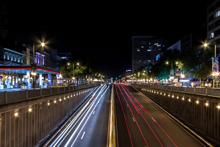 Streaming car light trails at Boulevard de Waterloo by night (Brussels, Belgium), motion blur photography