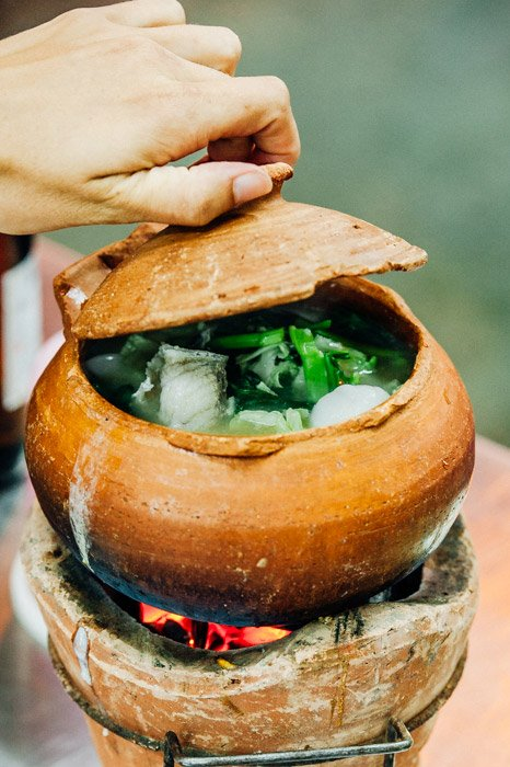 A bowl of delicious hot soup in a traditional cooking bowl - food photography tips