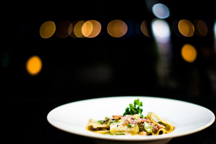 A food photo of pasta with atmospheric background