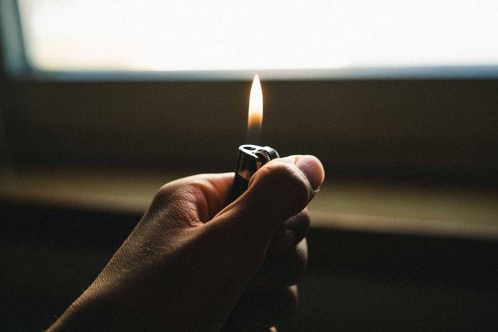 hands holding a lighter