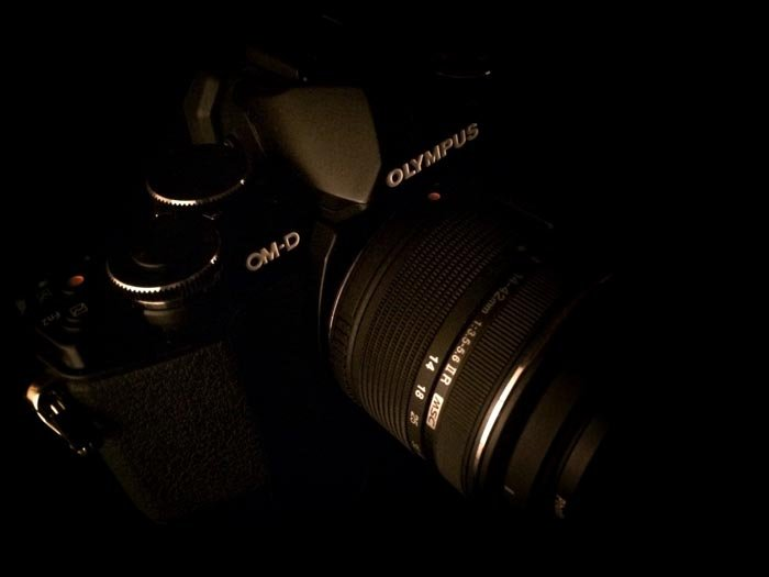 An Olympus camera with a black background