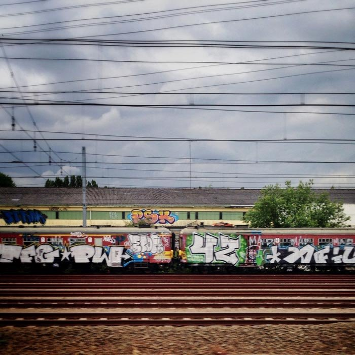 Rail roads and a train covered with graffiti