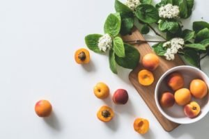 Tabletop photography of fruit and flowers