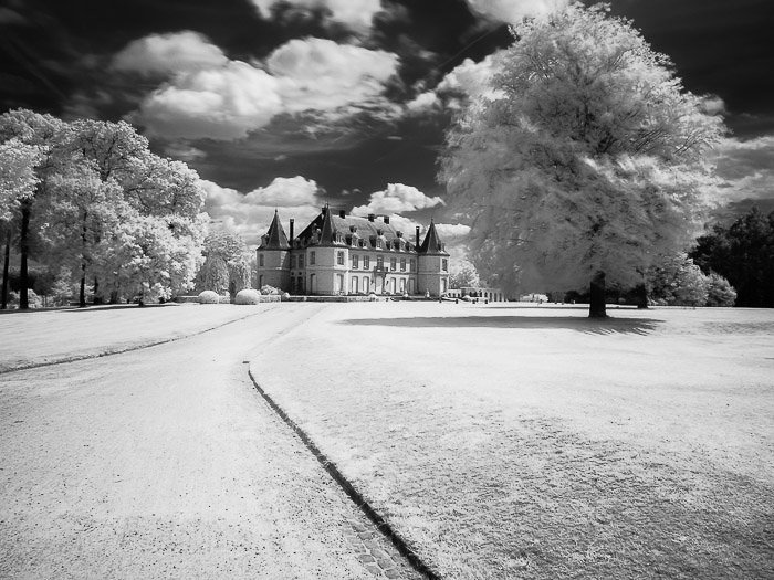 A black and white infrared photography of The Chateau de la Hulpe