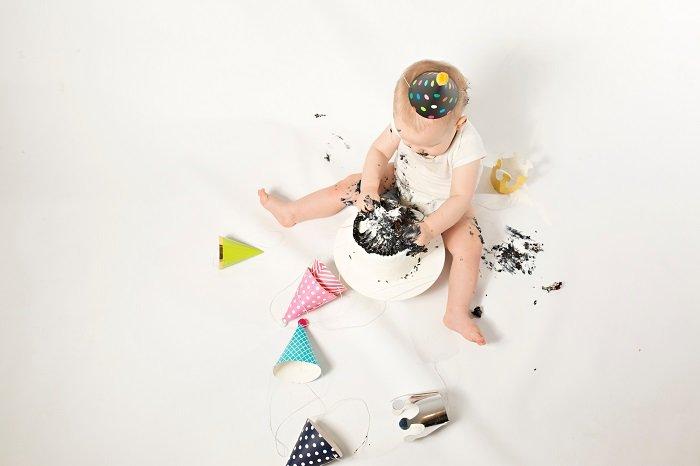 cute diy cake smash photo shoot of a little boy