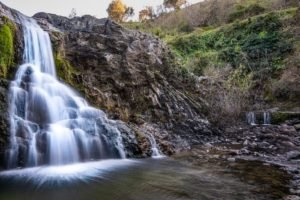 daytime long exposure photo of a small waterfall